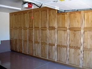 WE OFFER OUR GARAGE CABINETS WITH MANY TYPES OF WOOD AND FINISHES HERE IS A FINE EXAMPLE THE CUSTOM LOOK ALDER